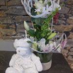 compositions fleurs naturelles et une pelluche